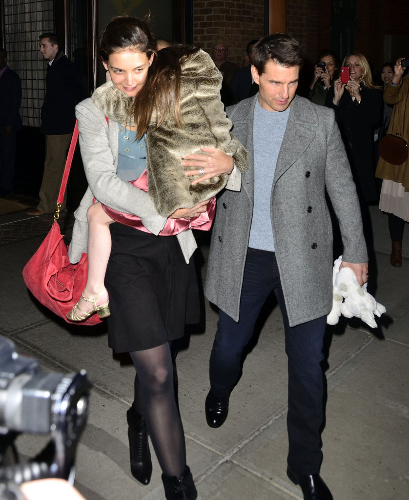 Suri Cruise held onto Katie Holmes leaving a NYC hotel.
