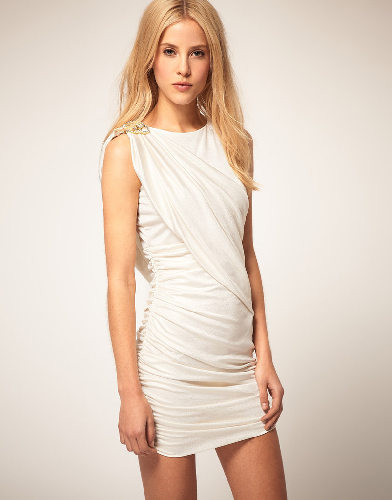 Slip into this white-hot minidress with a pair of ankle boots for a head-turning effect.  River Island Slinky Dress with Shoulder Detail (approx $48)