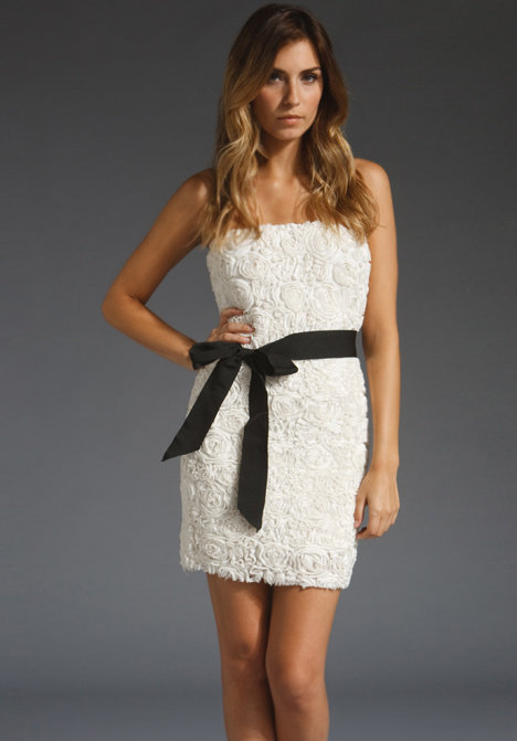 We love the beautiful texture of this simple LWD. Add black peep-toe pumps to finish the look.  MM Couture by Miss Me Strapless Rose Bud Dress (approx $83)