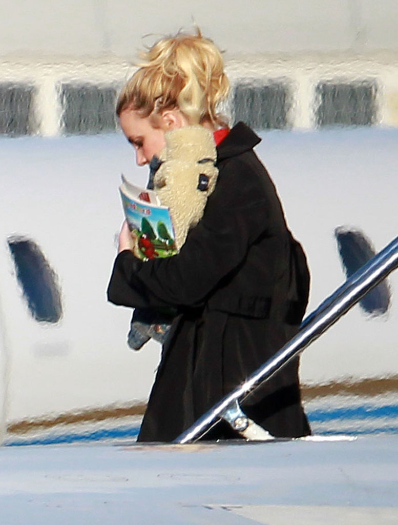 Britney Spears carried her belongings, including a new engagement ring, off a private plane.