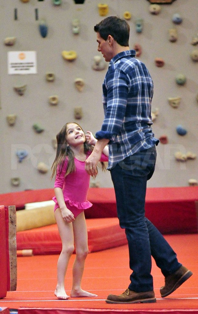 Suri Cruise smiled at her dad Tom Cruise.