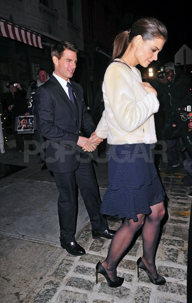 Katie Holmes and Tom Cruise held hands on their way out of a premiere party.