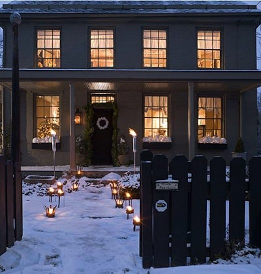 An illuminated pathway pays tribute to the elements of fire and ice.   Source: Cottage Living
