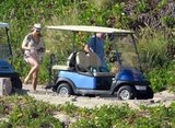 George Clooney and Stacy Keibler set out to explore Cabo by golf cart.