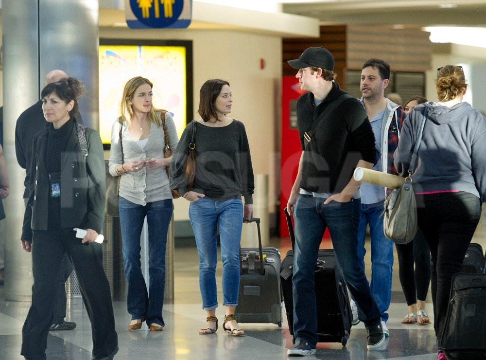 John Krasinski and Emily Blunt walked with Jimmy Kimmel and Molly Molly McNearney at LAX.