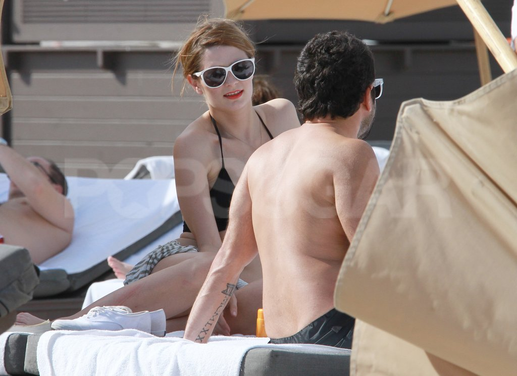 Mischa Barton flaunted her bikini body on a lounge chair in Florida.
