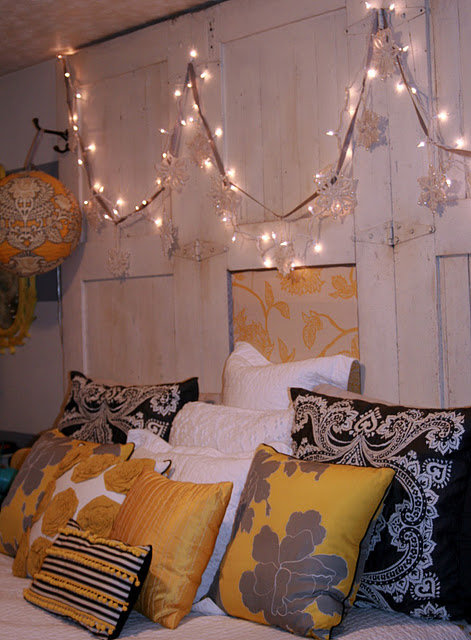 Loop lights above your bed as a temporary headboard. Source