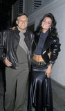 Hugh Hefner brings his date Carrie Lee to Billy Wilder's 1987 New Year's Eve party at Spago's.