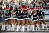 The Raiders cheerleaders, the Raiderettes, perform.