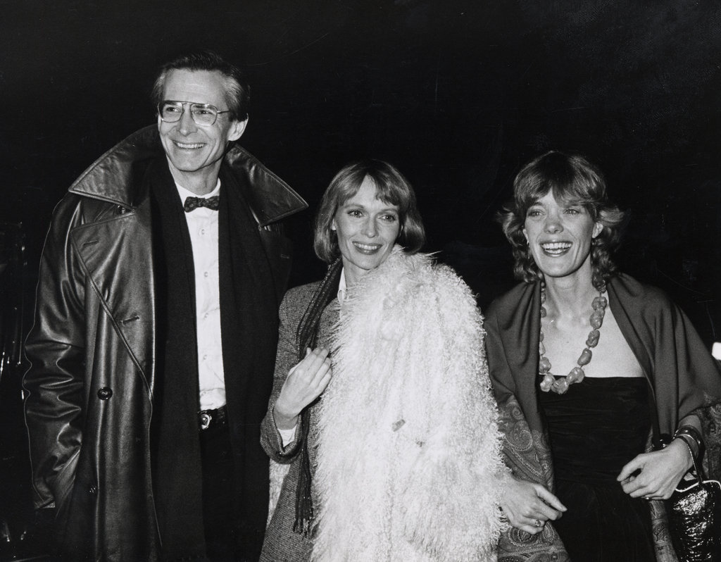Anthony Perkins, Mia Farrow, and Berry Berenson attend Woody Allen's 1979 New Year's Eve party in New York City.