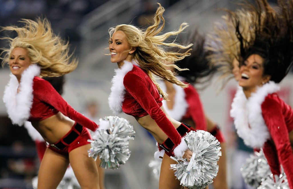 The Dallas Cowboys cheerleaders perform during half time.