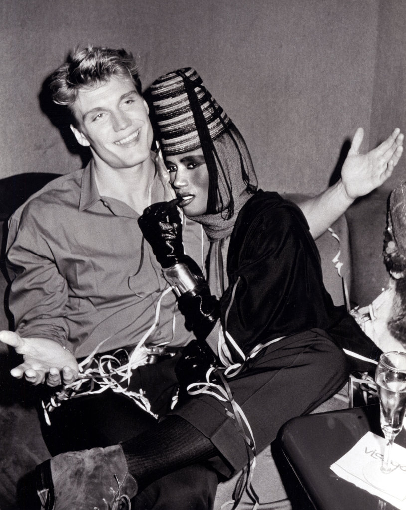 Dolph Lundgren and Grace Jones snuggle up at Grace's New Year's Eve performance in 1985.