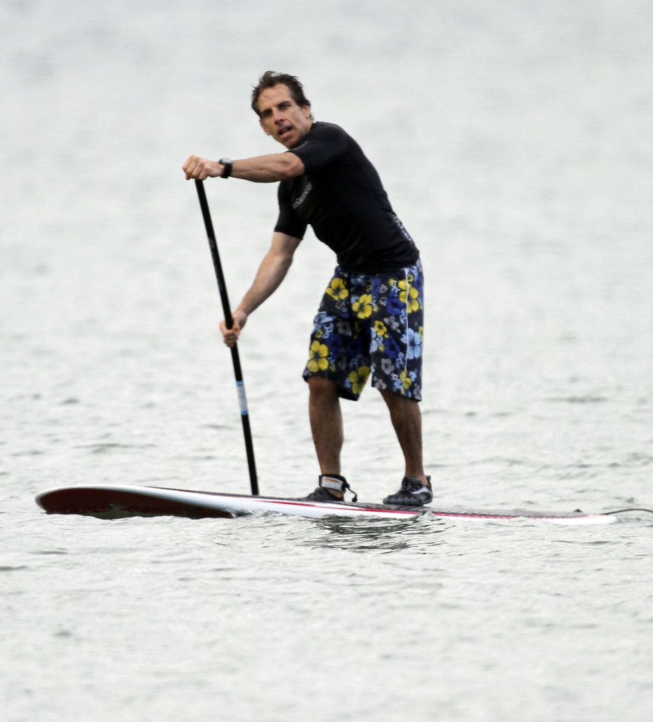 Ben Stiller paddled on his surfboard.