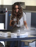 Kate Beckinsale removed her shoes at the security checkpoint.
