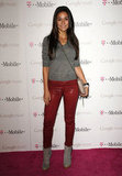 Emmanuelle Chriqui spiced up a gray sweater with a pair of waxed red-leather skinnies. Shop the look:
