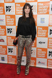 Charlotte Gainsbourg's metallic trousers make a black tee event-worthy.