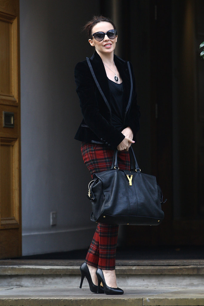 Kylie Minogue's plaid pants add a festive touch to a black blazer.