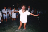 Tina Turner dances in the sea on New Year's Eve 1988 in Rio de Janeiro, Brazil.
