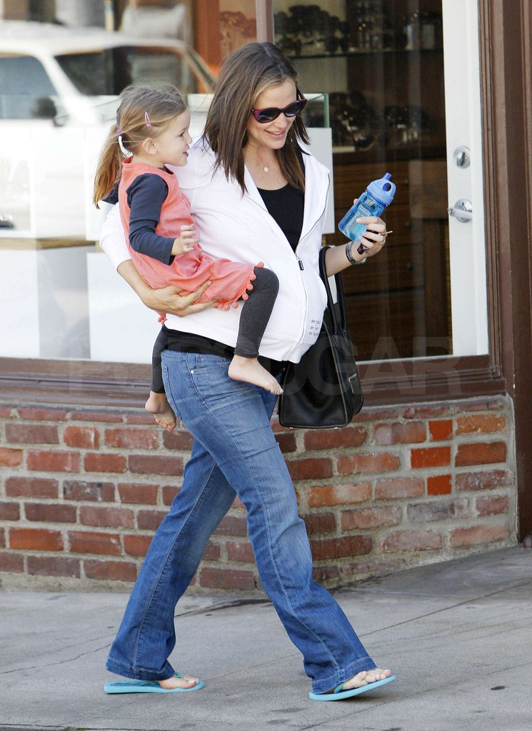 Jennifer Garner covered her baby bump with a hoodie as she carried Seraphina Affleck.