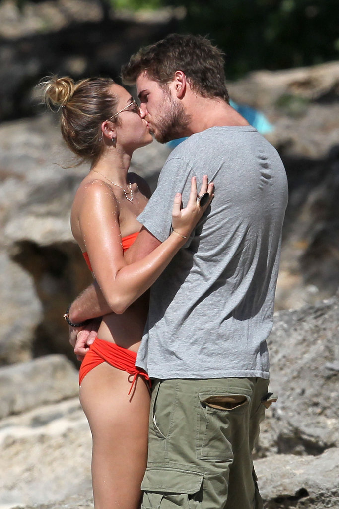 Liam Hemsworth and Miley Cyrus engaged in a little beachside PDA.