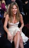 Jennifer Aniston sat pretty in a white gown and beachy waves in 2007.