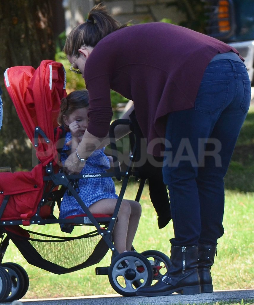 Jennifer Garner buckled Seraphina Affleck into her stroller.