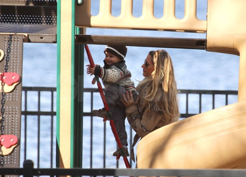 Gisele kept a close eye on her little man.