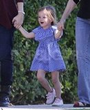 Seraphina Affleck skipped in a pretty blue dress.