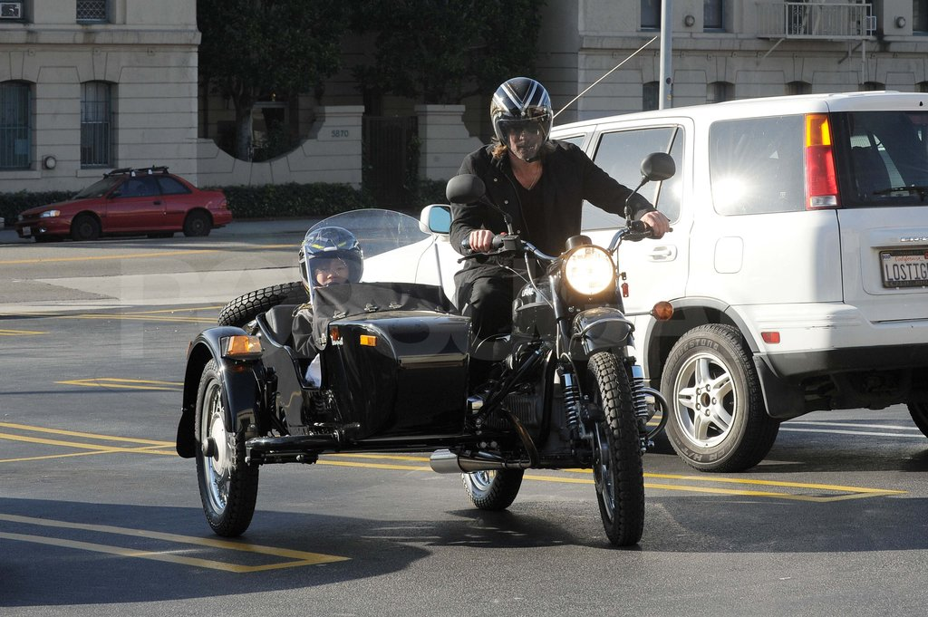 Brad Pitt driving Pax on a sidecar motorcycle.