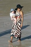 Rachel Zoe carrying Skyler on the beach.
