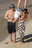 Shirtless Rodger Berman with Rachel Zoe and baby Skyler on the beach.