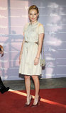 """For this red-carpet look, Kate Bosworth donned maroon pointy pumps, a Mulberry safari-inspired cargo dress, and a Mulberry """"Harriet"""" shoulder bag."""