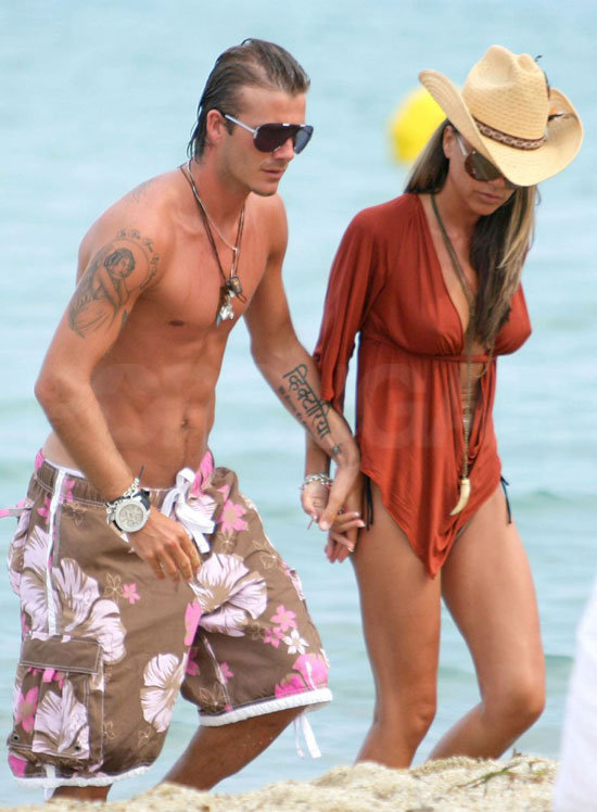 David Beckham was shirtless for a seaside stroll in July 2005 with Victoria on a St. Tropez getaway.