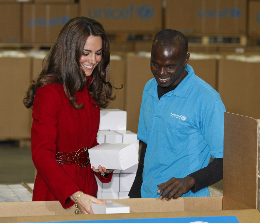 Kate packs relief boxes during her royal visit to the UNICEF emergency supply center in Copenhagen.