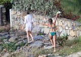 Julianne Hough walked on a rocky path in her bikini.
