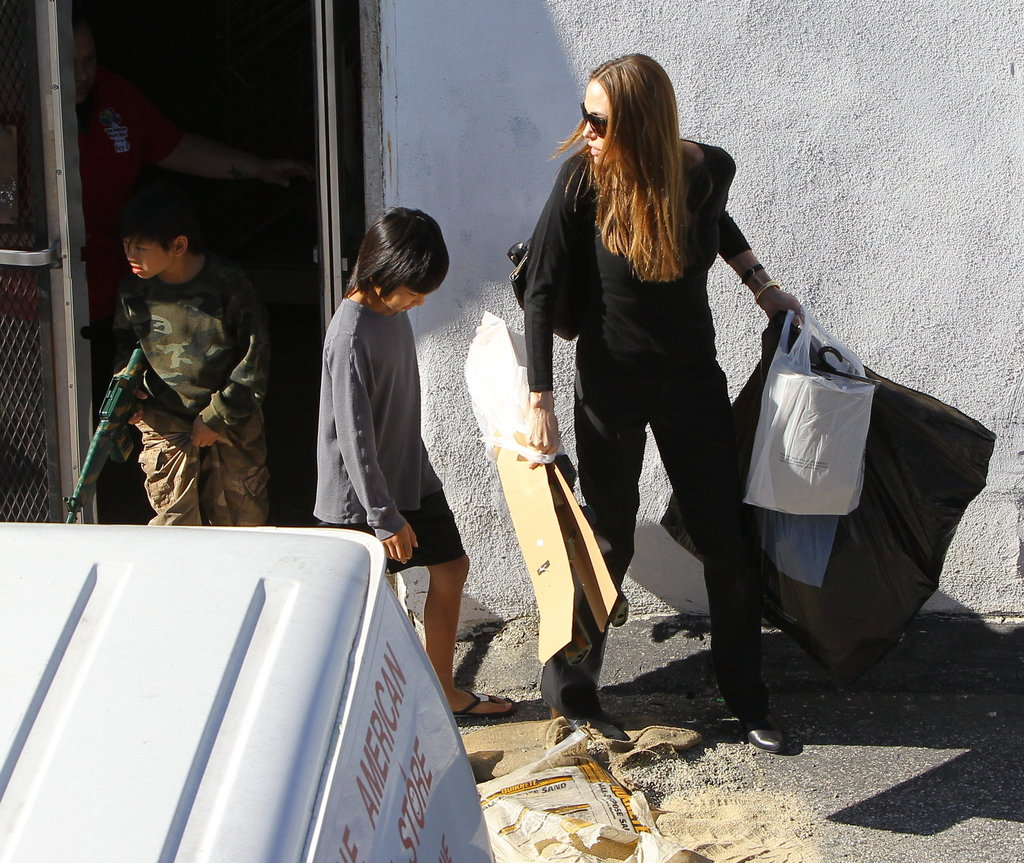 Pax and Maddox Jolie-Pitt helped Angelina Jolie shop for party supplies.