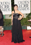 Mila Kunis in a black Dior gown.