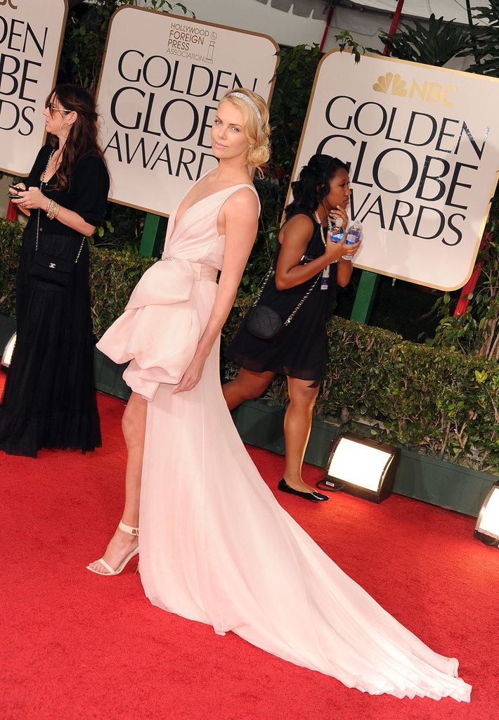 Charlize Theron Shows Leg in Her Glam Dior at the Globes