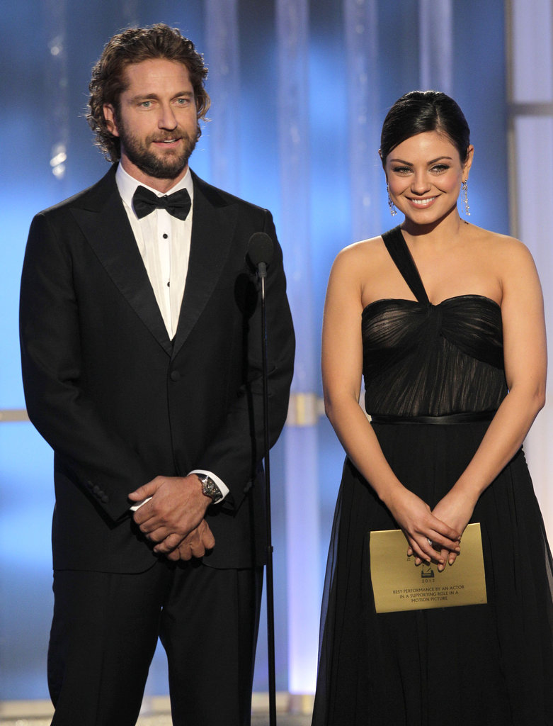 Mila Kunis stepped out in Dior on stage with Gerard Butler at the 2012 Golden Globe Awards.
