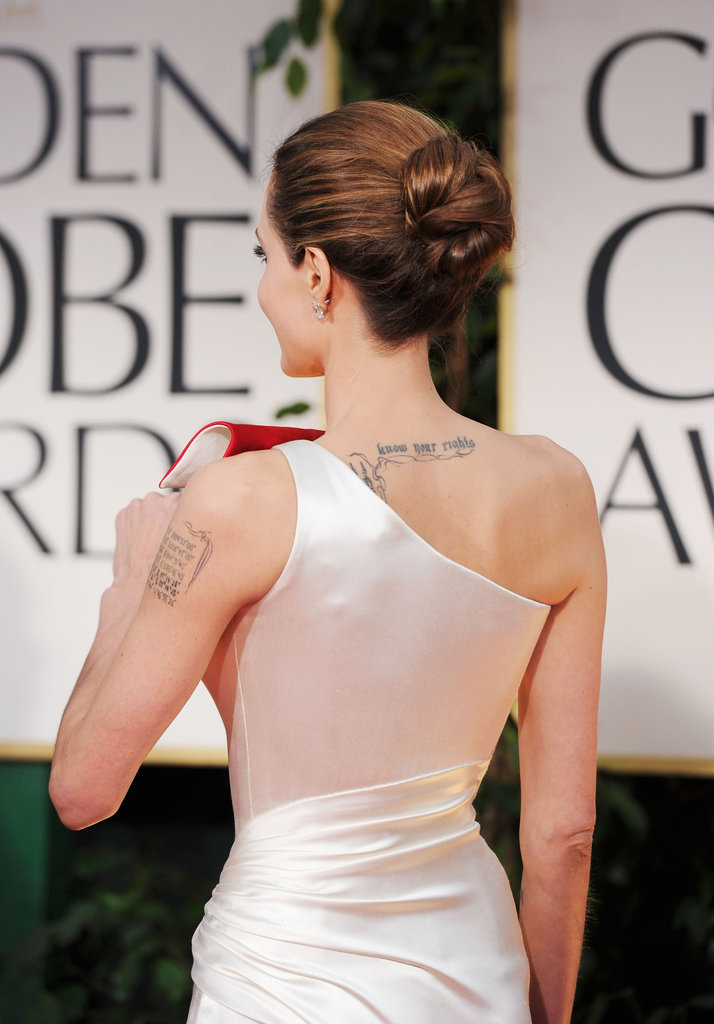 Angelina Jolie showed the back of her Versace dress.