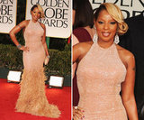 Mary J. Blige made her appearance on the red carpet tonight wearing a shimmery halter gown, embellished with soft feathers down below. The singer then added glitz to her ensemble with bejeweled cuffs on both of her wrists, chandelier earrings, and an envelope clutch.
