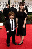 Game of Thrones's Peter Dinklage and Erica Schmidt walk the carpet.