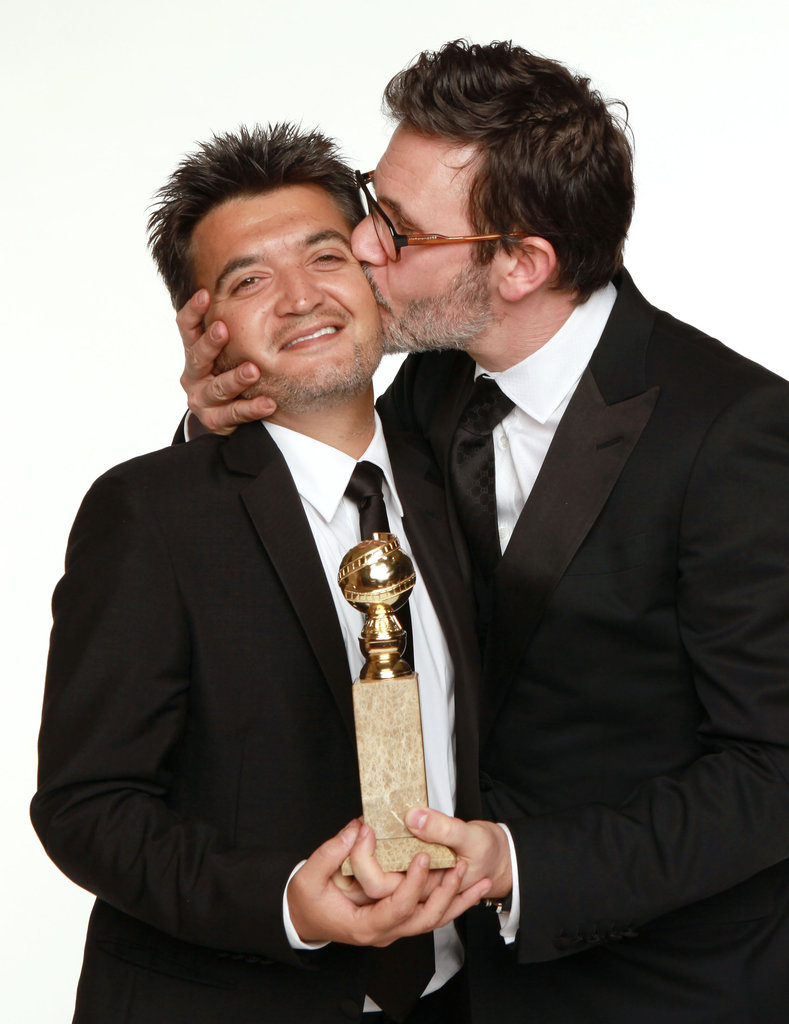 The Artist's producer Thomas Langmann and director Michel Hazanavicius get affectionate.