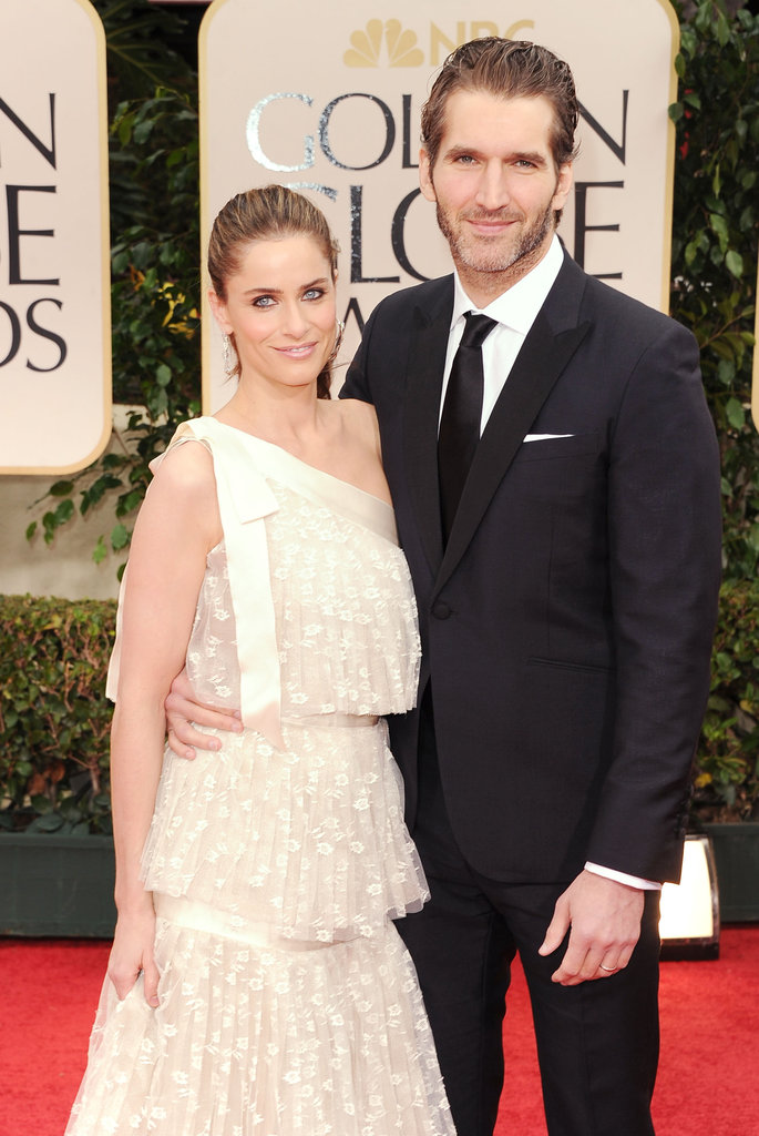 Screenwriter David Benioff and his wife actress Amanda Peet make their way in.