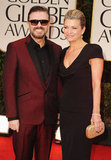 Host Ricky Gervais and his partner Jane Fallon walk the red carpet.