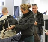George Clooney followed girlfriend Stacy Keibler at LAX.