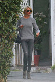 Cameron Diaz wearing a gray outfit.