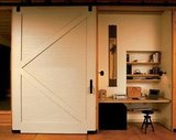This sliding barn door can easily hide a small office space when work isn't top of mind.  Source