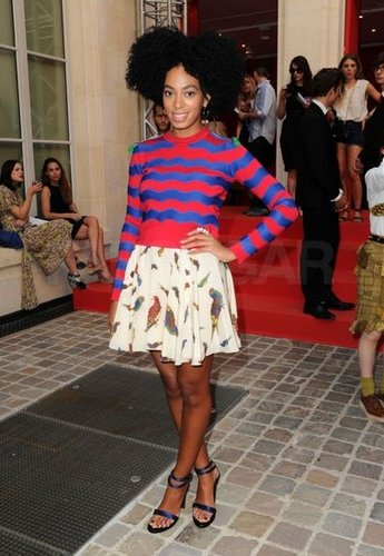 Solange, in a striped sweater and bird-print skirt, brought two unlikely patterns together for a fresh, fun daytime look.