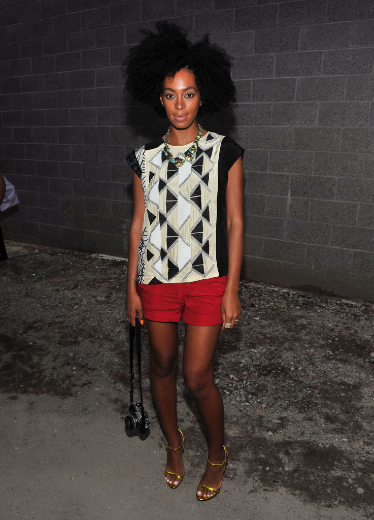 During Spring 2012 NYFW, Solange made her geometric-print tank look fresh and modern by pairing it with tailored red shorts and thin-strap neon sandals. Her chunky beaded necklace was also totally on point.
